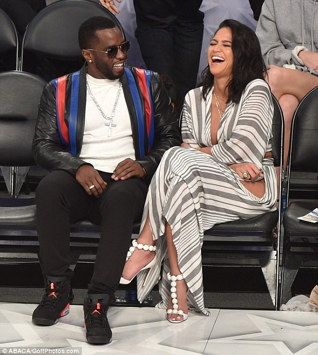 Diddy's Cuddles Gorgeous Girlfriend Cassie As She Flashes Major Leg At NBA All-Star Game